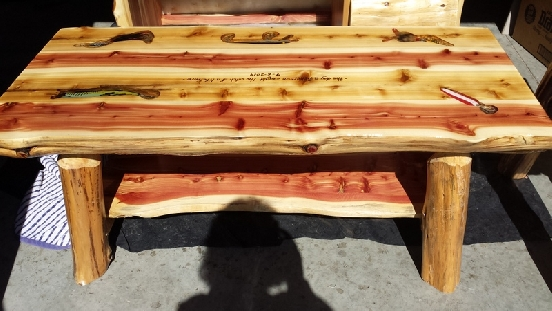 Fishing Lures Embedded In A White/Red Cedar Coffee Table Top.